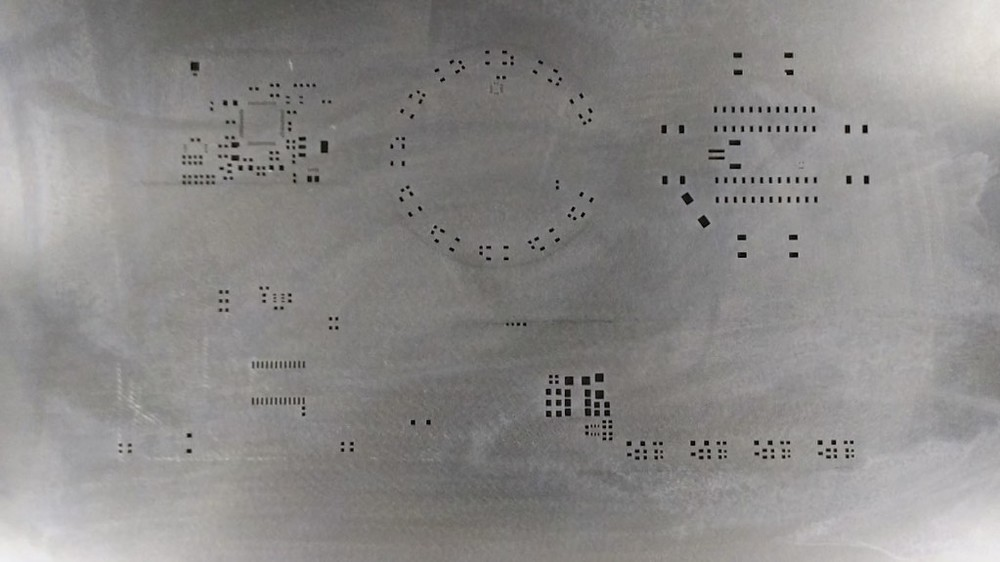 This 5-in-1 lasercut solder stencil from SZ-JLC set us back $8.06.  Pretty nifty.