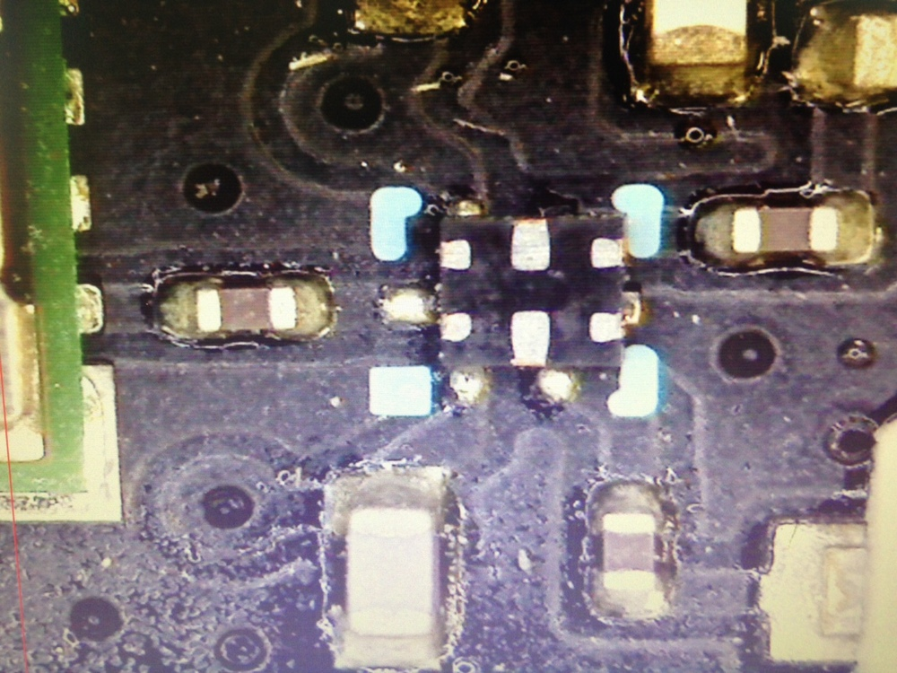 This component, a small RF switch in a QFN package, was somehow soldered to this Photon prototype completely upside down and rotated 90 degrees. There were solder connections that reached up the sides of the part to the pads that kept it fixed in place, and the prototype could even (barely) connect wirelessly to the Internet!