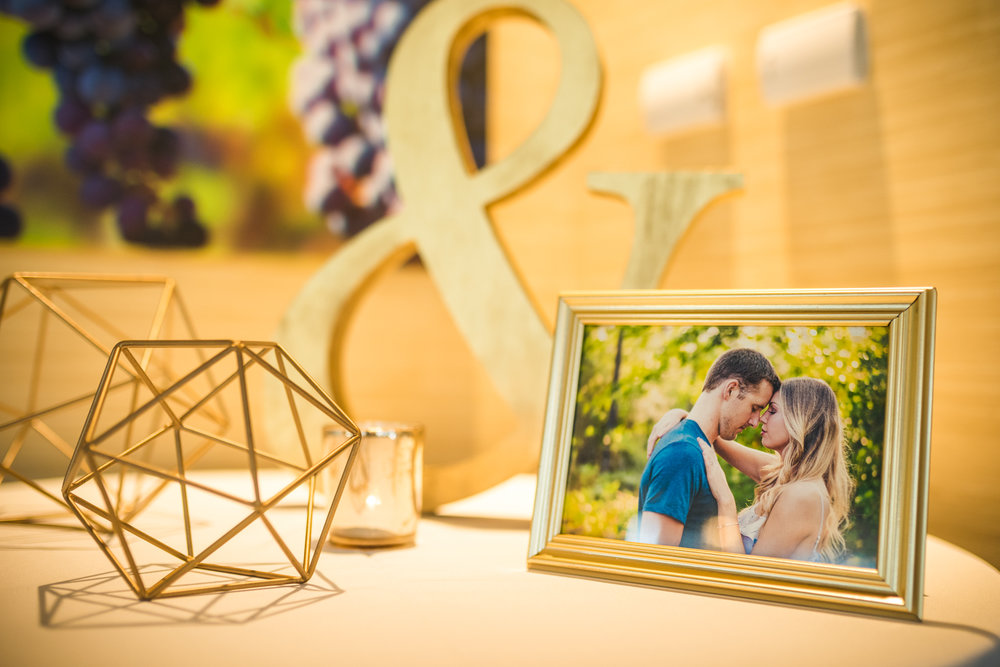 The photo in the frame was taken by  Alex & Cammy Wedding Photography.