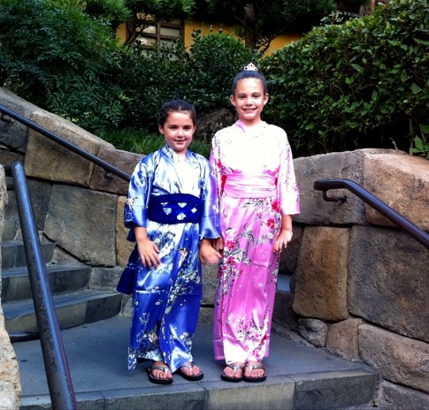 Maddie and Amelia after getting kimonos in the Japan pavilion.