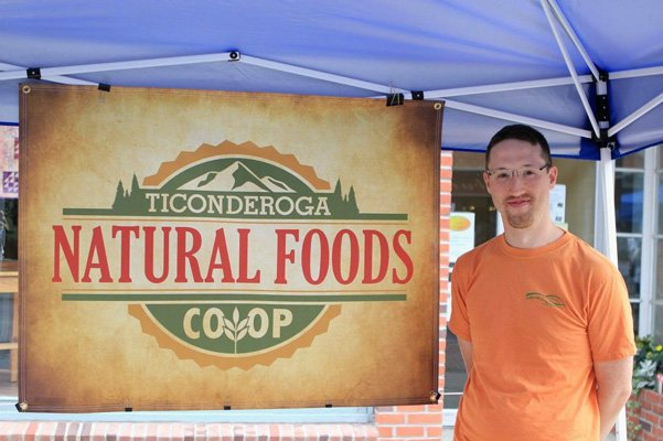 Eric Stoddard at the Natural Foods Co-op booth. Photo by Nancy Frasier.