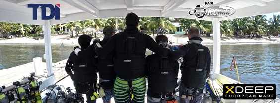 5 technical sidemount divers in the Xdeep sidemount harnesses, they are on the dive boat bottom time that belongs to coconut tree divers in roatan, west end, honduras.