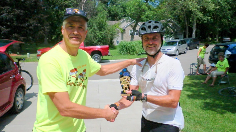 Jim Smith awarding me the Most Improved Lemming. Yes, the trophy has a lemming wearing a cape - it is awesome.