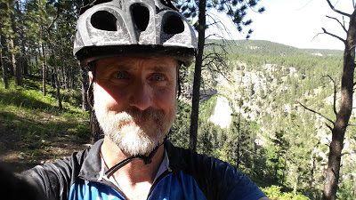 "Selfie on a climb with a nice ""canyon"" on the right. Somewhere near mile 65?"