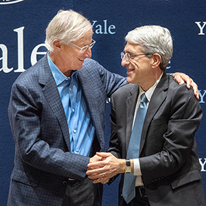 Nordhaus and Salovey embrace during a press conference at the School of Management. (Photo credit: Mara Lavitt)