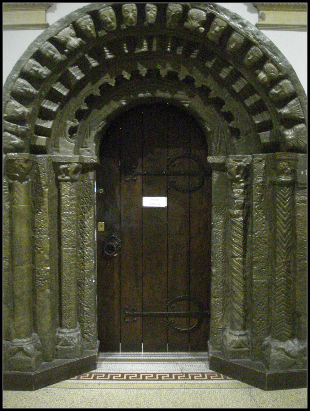 "Although it is a reproduction, this doorway is rather impressive.  ""What lies beyond?"", she wondered."