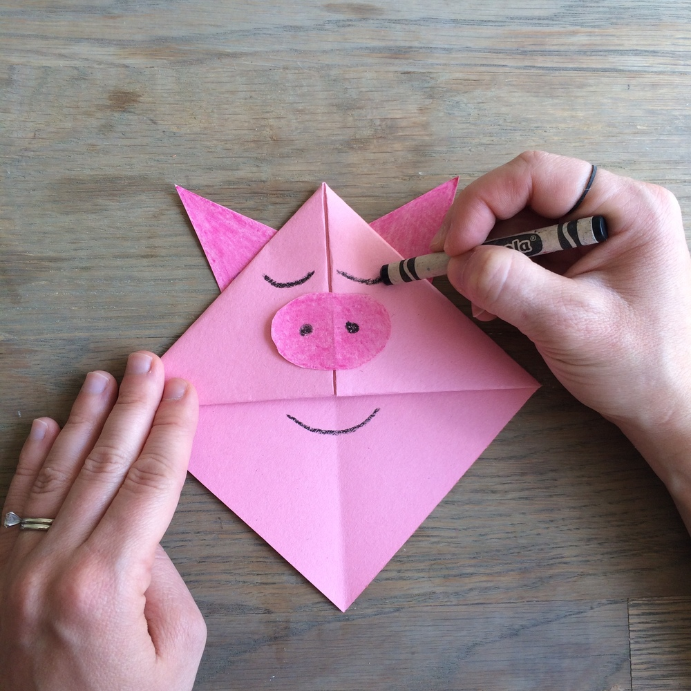 Step 10:  Use your black sharpie or crayon to draw in Zen Pig's nostrils and trademark blissful eyes and smile.