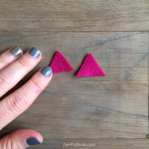 3. Cut two small triangles (about the size of your pinky nail) out of the felt.