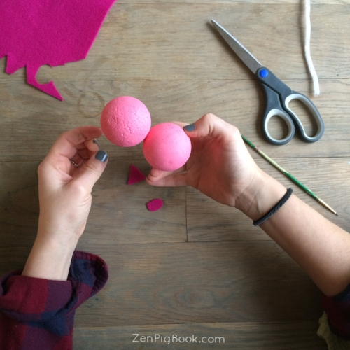 5.  After your pink paint has dried, push the styrofoam balls together until they meet in the middle.