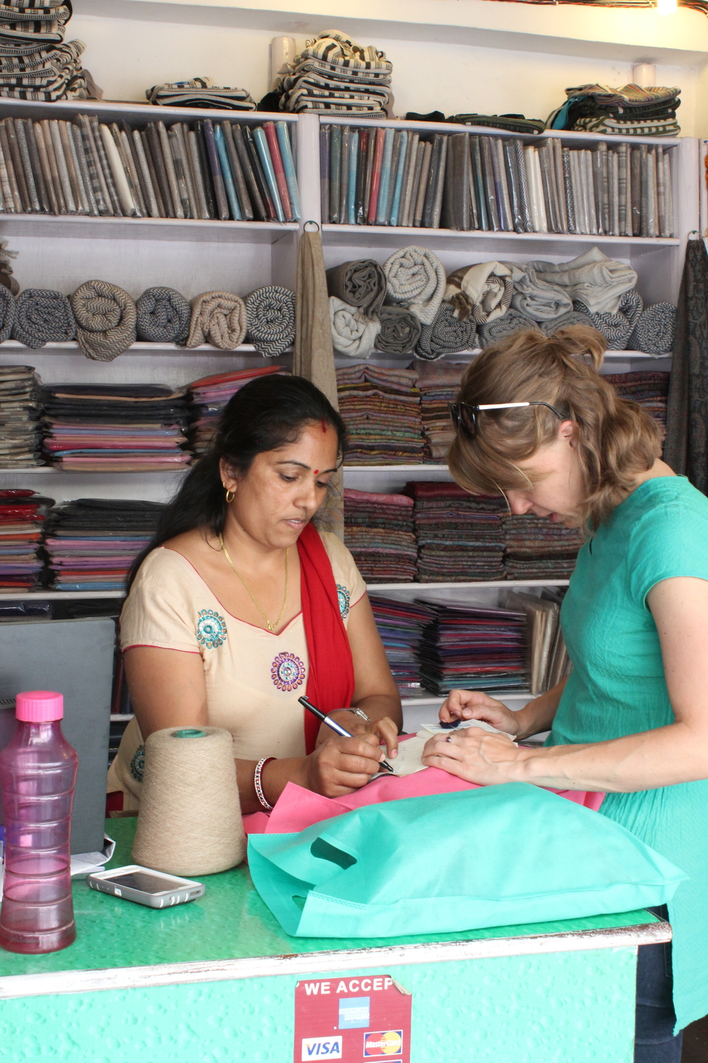 Founder Amanda collaborating on new designs with our partners in Nepal