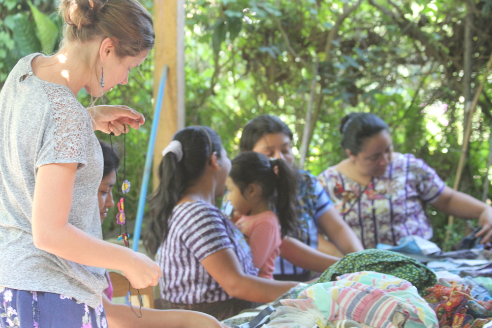 Founder of La Puerta Abierta Amanda Flayer working with the artisan mother group in Santiago, Atitlan.
