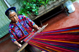 Guatemala- This woman is working on a back strap loom, an ingenious invention that allows weaving to be done almost anywhere without lugging around a big cumbersome floor loom. This is how Living Threads' natural dye blankets are made!