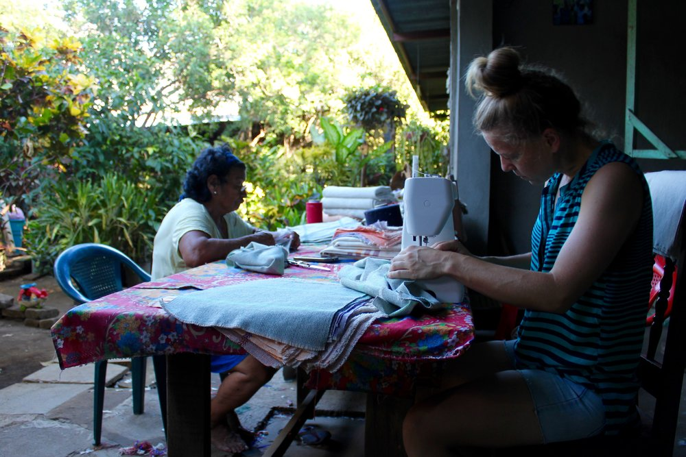 Founder Amanda with partner artisans in Nicaragua working on new designs and finishing techniques.