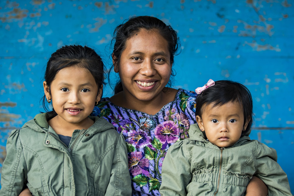 Connecting with the women and families that inspire us each day and continue to make Living Threads Co. what it is today.  Sandra with her two daughters in Santiago Atitlán, Guatemala.