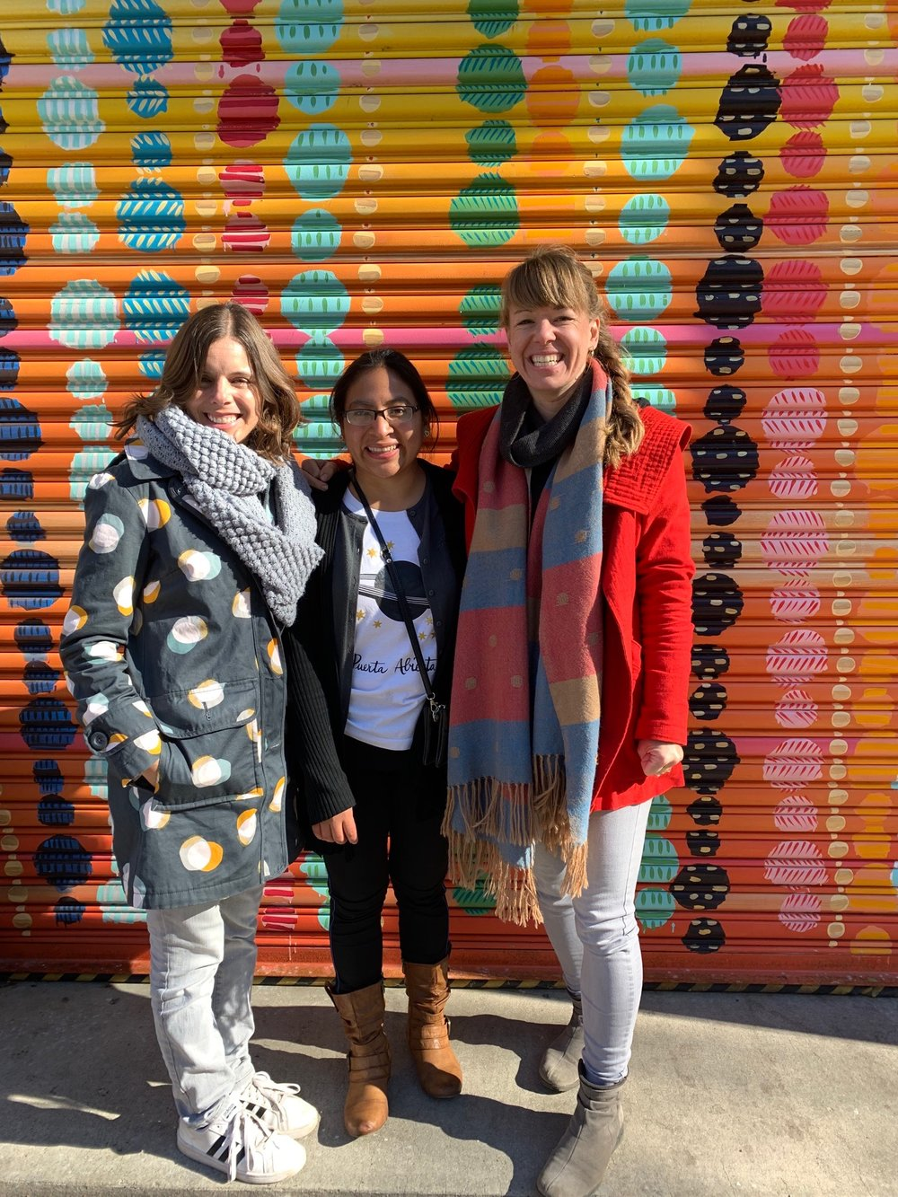 Amanda Flayer (Founder of La Puerta Abierta in Atitlán, Guatemala), Ana Mesia (Artisan and teacher at La Puerta Abierta in Atitlán, Guatemala), and Amanda Zehner (Founder and CEO of Living Threads Co.) exploring DC after their arrival.