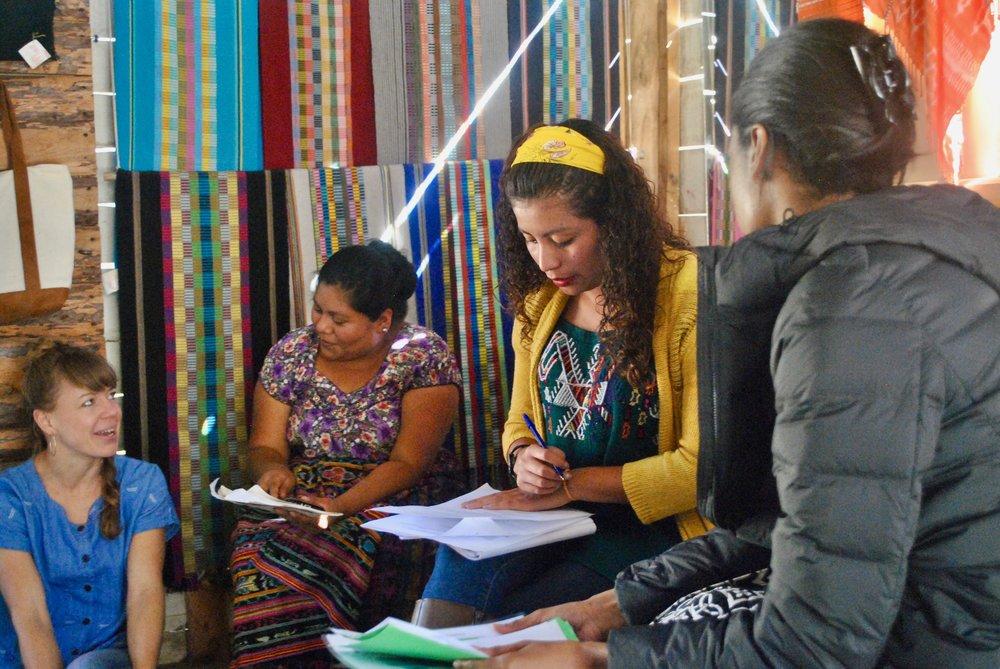 Amanda Zehner (Founder & CEO), Amalia (President of Tinte Maya Artisan Cooperative in San Juan), Isa (Translator), and Stacy (GW International Development Graduate Student) discussing the week's schedule.