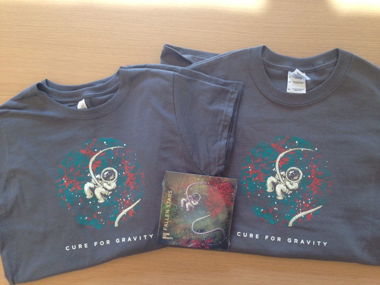 New Cure for Gravity shirts in da house!  Come grab yours at the Milk Bar show tomorrow night in San Francisco!  Buy two and get a copy of our Fallen Stars EP for Free!    http://www.milksf.com/shows/epilogues-gold-medalists-cure-gravity-together-we-can-rule-galaxy