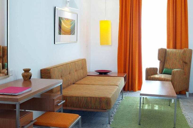 GREECE-Mykonos Theoxenia-Junior Suite-orange-sitting-area.jpg
