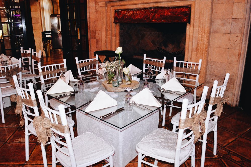 Low tables with rustic inspired centerpiece