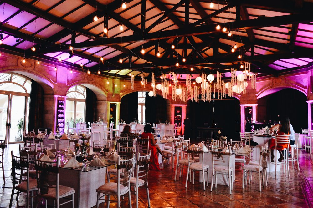Colored uplights, paper lanterns, dangling white floors add a rustic vibe to the venue