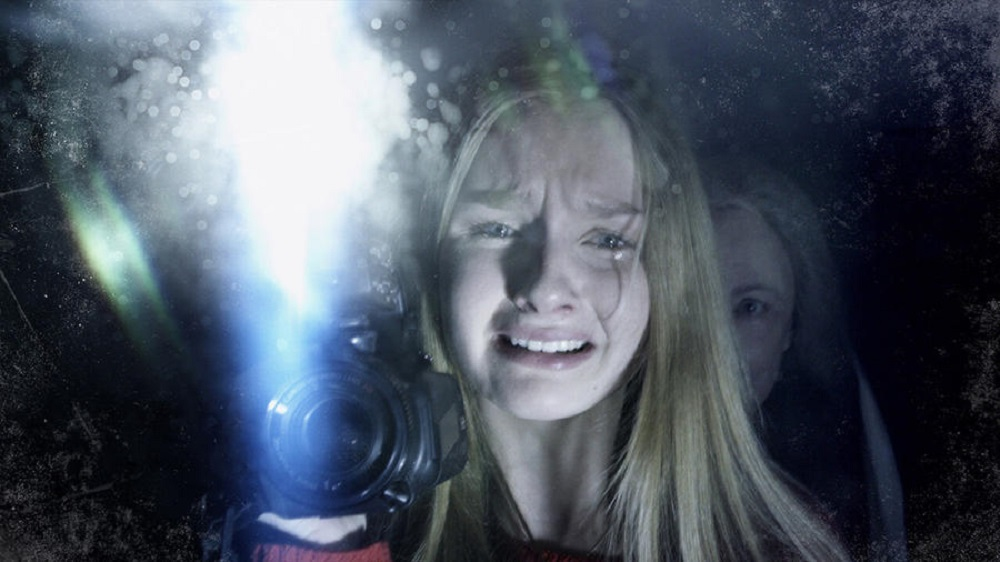 Becca (Olivia DeJonge) finds herself in a world of fear in  The Visit.  (Blumhouse Productions / Universal)