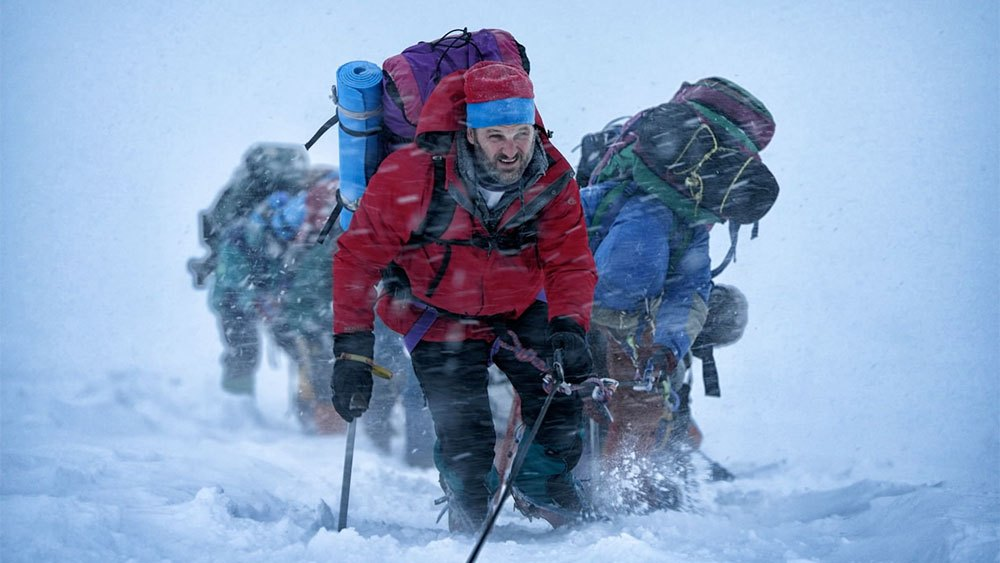 Rob Hall (Jason Clarke) leads his team up the mountain in the thick of snow. (Universal / Walden Media)