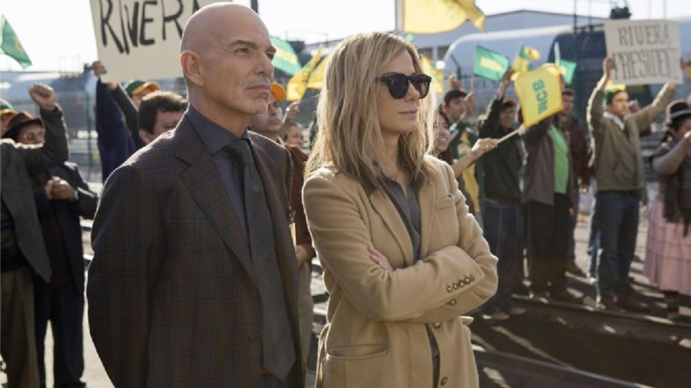 Jane (Sandra Bullock) and Pat (Billy Bob Thornton) are campaign-managing opponents in Our Brand Is Crisis. (Participant Media / Warner Bros.)