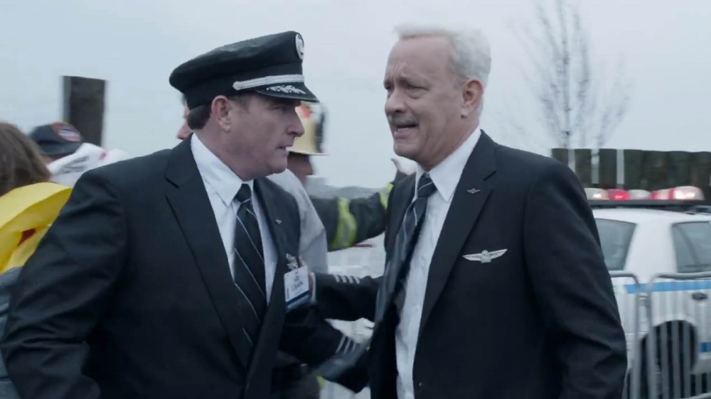 "Sully is famously known for being a rather ""shy and reticent"" man, even after his newfound celebrity. Tom Hans perfectly executes those sides of the man's personality, fitting right into Clint Eastwood's muted, yet resonant movie. (Warner Bros.)"