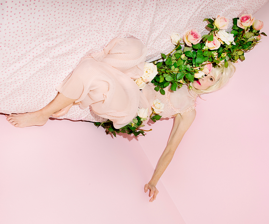 Natalie Krick,  My mother in bed with roses , 2015; from the series  Natural Deceptions