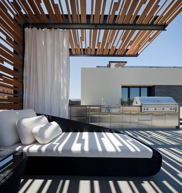 Tresarca Residence image via:   assemblageSTUDIO     With an outdoor kitchen and a daybed, this is a luxurious rooftop living area.  Use curtains and textured structures to add shade that won't hinder your view.