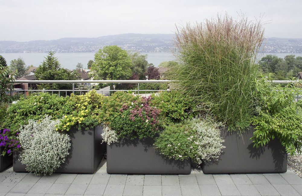 Planters designed by Willy Guhl   To achieve a feeling of abundance, fill planters with a contrasting mix of plants.