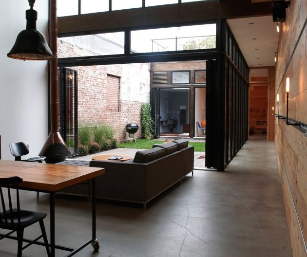 An internal courtyard adds a sense of calm to this New York city home.  Image via Inhabitat.
