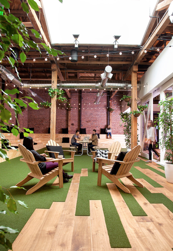 Natural materials and a connection between indoors and out are key elements of biophilic design. Image via studio hatch.