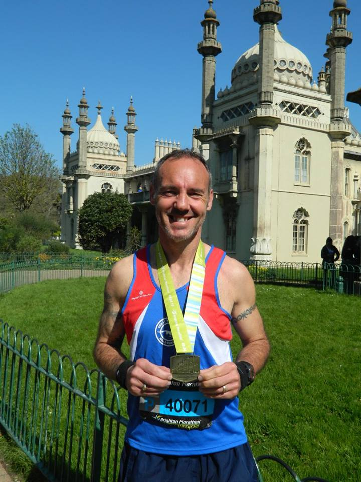 A beaming smile from Andrew Dormer proudly showing off his first (of many) marathon medals.