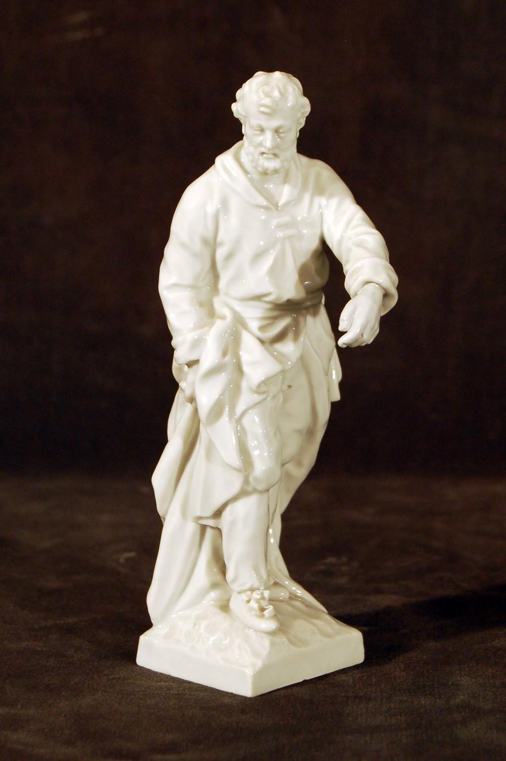 """Porzellanfigur """"Hypokrates"""", Szeptermarke 19.Jh für Berlin, Höhe ca. 15cm"""