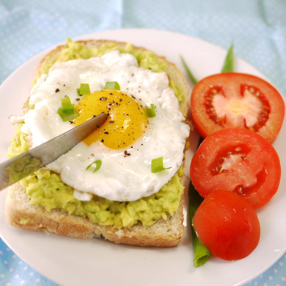 avocado toast with runny sunny side up