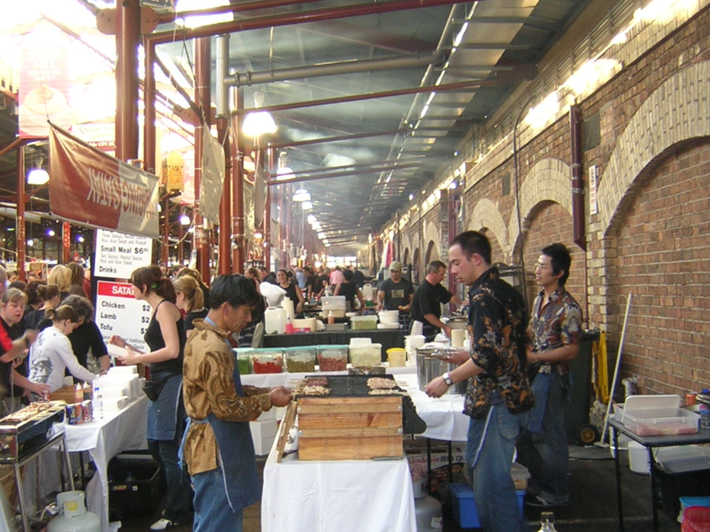 Chris and Merv (right, far right) at season 3 of the night markets, December 2004.