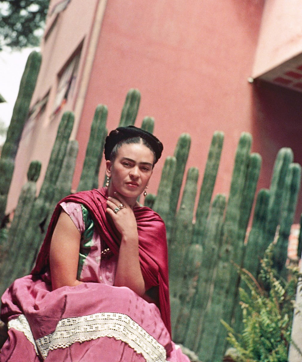 Frida in Front of the Cactus Fence, San Angel, 1938. © Nickolas Muray Photo Archives.
