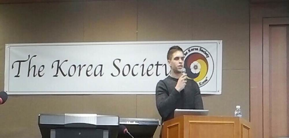 Justin Davis, of The Korea Society, gives the opening remarks.
