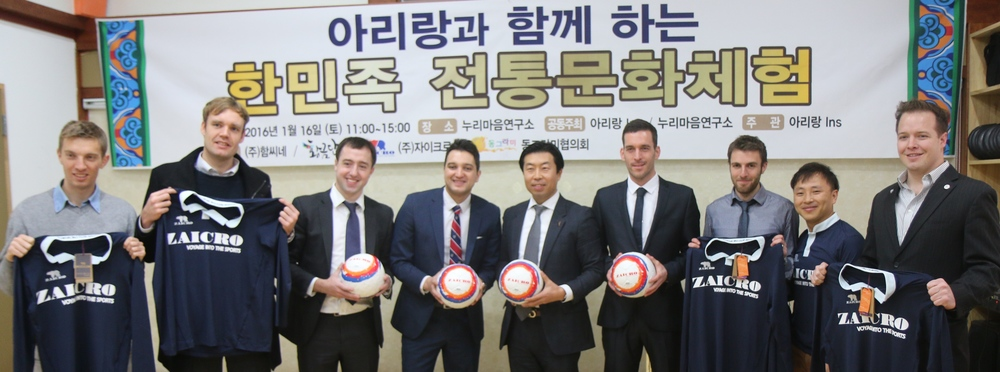 From Left to Right: Tom Norris ~ AI Cooperation Director, Mark Sample ~ Team Captain, Matthew Fennell~ Team Manager Joe Hutahaean ~ Head Coach, President Choi ~ Zaicro, James Finney ~ Director of Football, Jon Boulty ~ Player, John Lee ~ Hometown Football Director, Michael Lammbrau ~ AI Seoul Bureau Chief