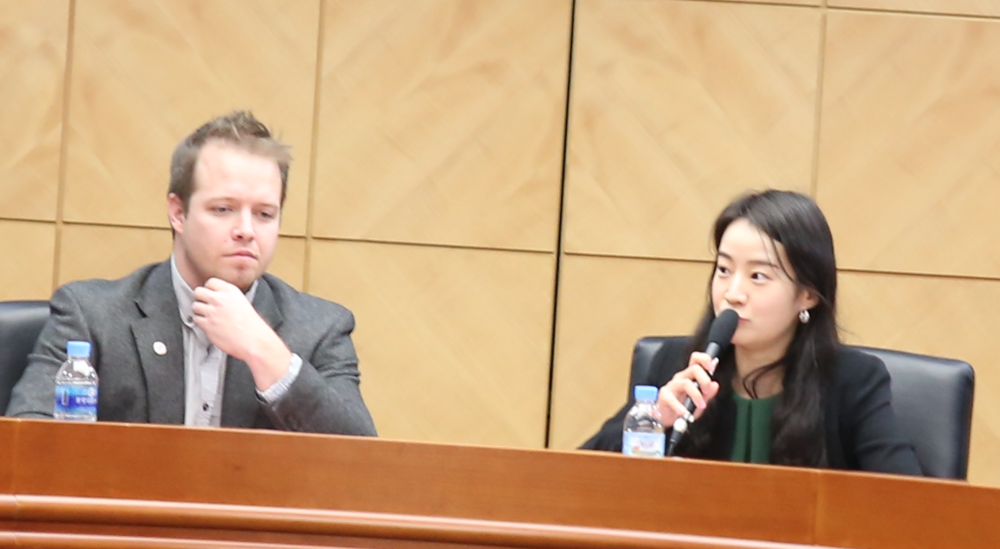 Left to Right: Professor Michael Lammbrau;  Journalist Ms. Lee Jin-woo