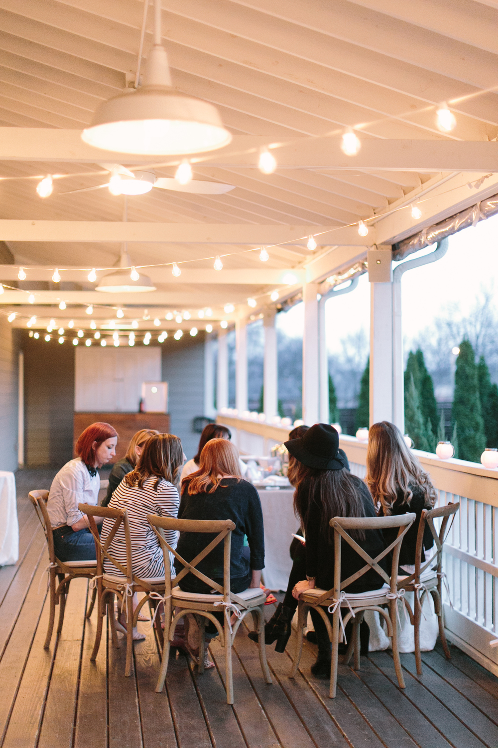 speed dating-workshop-creatives-community over competition-outdoor seating-porch inspiration-southern style-string lights-