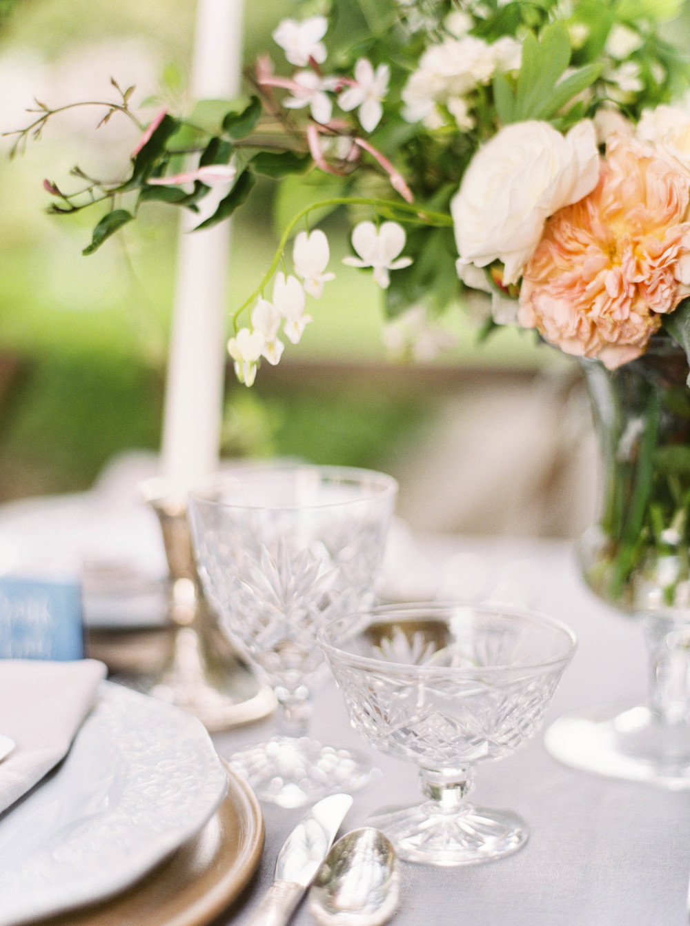 Wedding reception-vintage glassware-floral centerpiece-fine wedding photography-tablescape-outdoor wedding reception-neutral palette-
