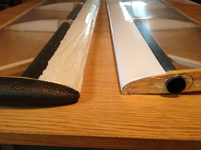 Side-by-side comparison of revised leading-edge on the canards, on left with smoothed polystyrene and on the right with paper surface.