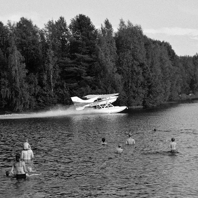 """Weird landing spot?"" (Finland July 2014) While traveling through Finland, I pauzed at a lake to have a swim, when suddenly this plane landed very close to us. My first thought was that there must have been a technical problem; but actualy, the pilot just landed his plane, dropped someone off at a pier and took off again. Coming from an urbanised country like Belgium, this is a very peculiar situation."