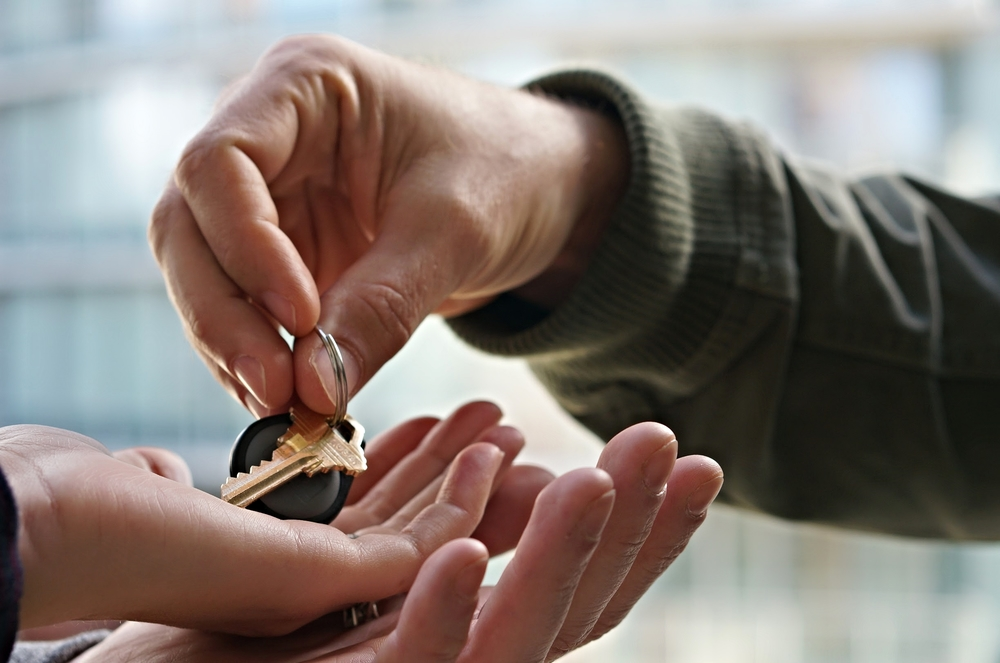 Handing the key for new home purchase