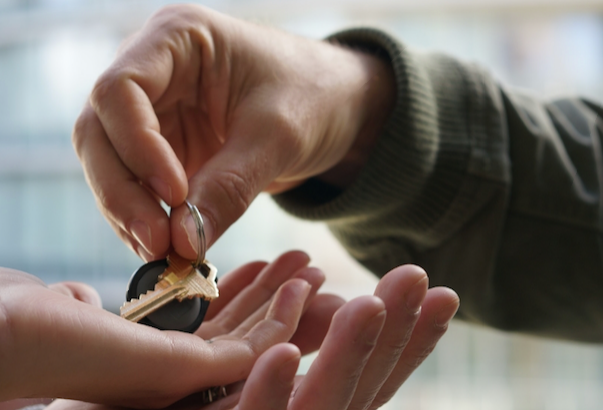 Handing keys to new homeowners