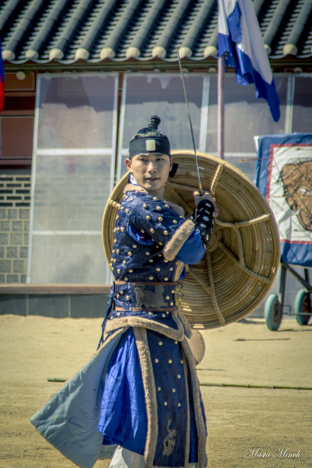 A martial artist dressed up as one of the King's Guards demonstrating the 24 Martial Arts