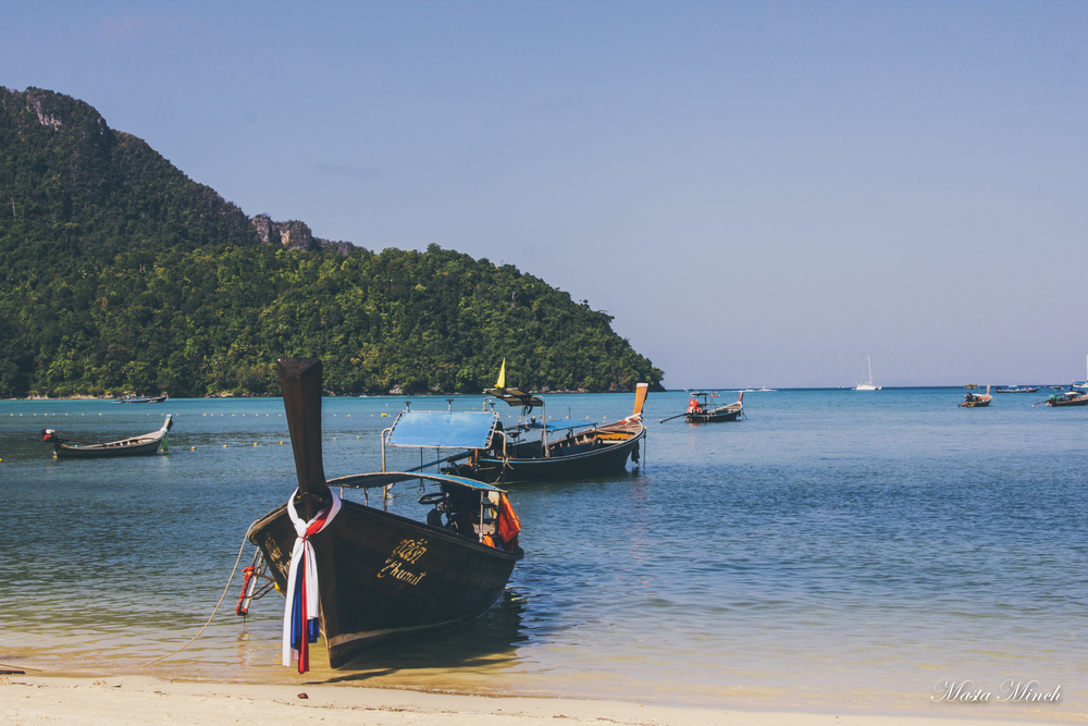 Longtail Boats sitting out on the beach of Koh Phi Phi