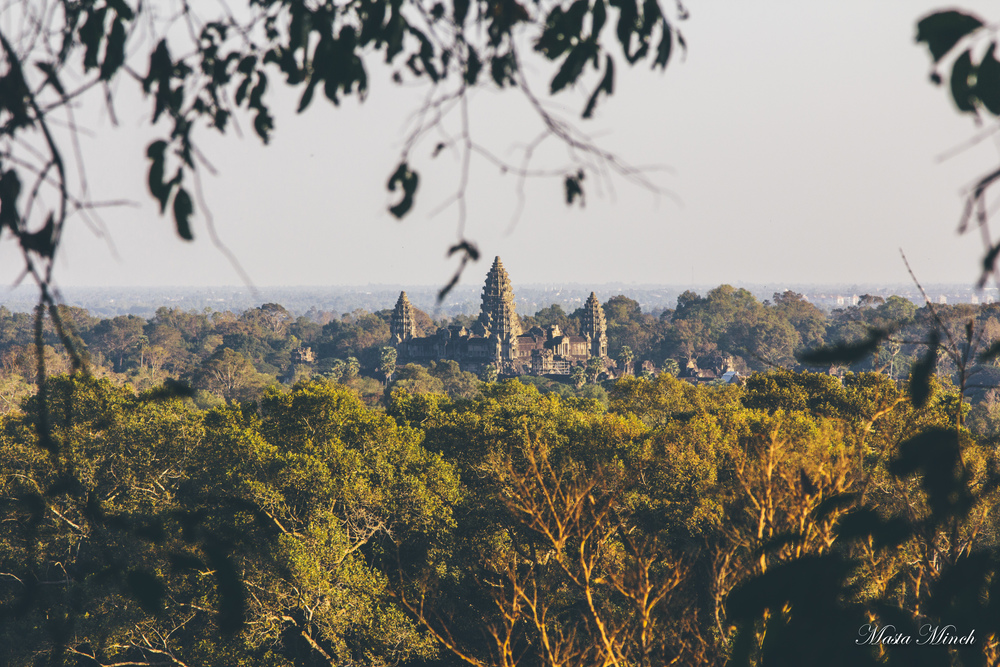 The view of Angkor Wat from the top of a hillside.